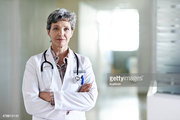 you are in capable hands - female doctor stock photos and pictures