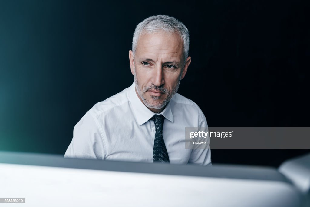 You can always find him behind his monitor : Stock Photo