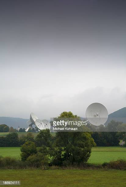 CONTENT] You can see the big satellite dishes of a ground communication Station in the middle of the green nature