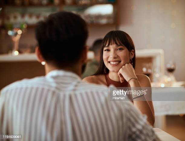 you can tell that she's falling for him - dating stock pictures, royalty-free photos & images