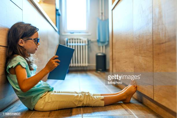 you can't keep a good book down - reading stock pictures, royalty-free photos & images