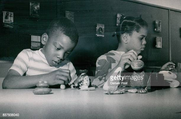 You Can't take youngster's Imagination for Granite in Rock Art George Pegues and his sister Cheryl are making a frog and a turtle respectively in...