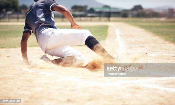 you can't win without a little dust - baseball player stock pictures, royalty-free photos & images