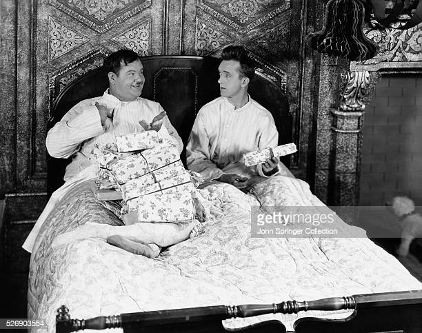 'You didn't get anything all this is for me' The two boys in the bed are Stan Laurel and Oliver Hardy Hal Roach MGM famous comedy team who have just...