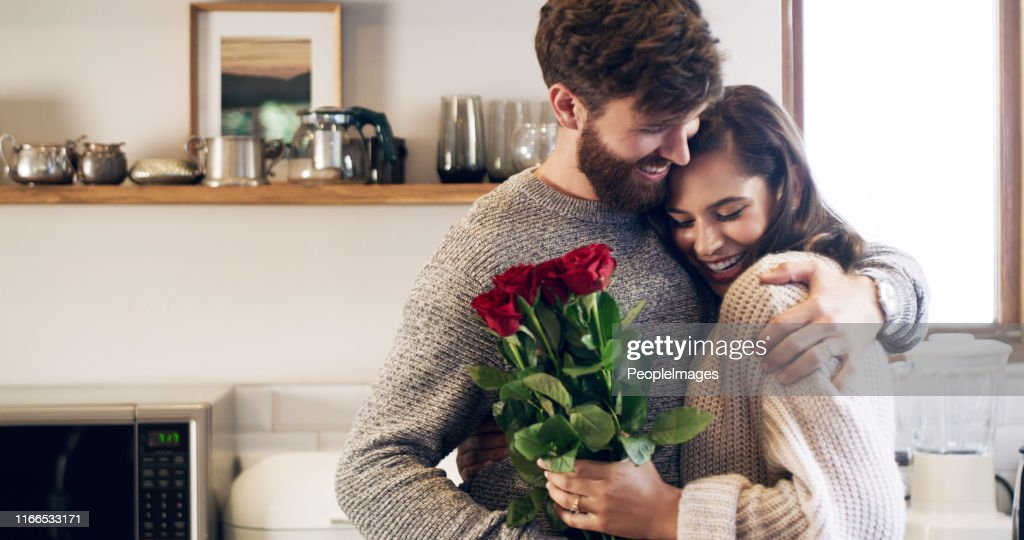 You don't need a reason to give her flowers : Stock Photo