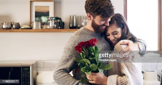 you don't need a reason to give her flowers - boyfriend stock pictures, royalty-free photos & images