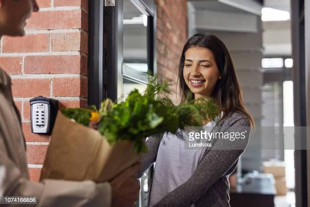 you got here much faster than i expected! - grocery delivery stock pictures, royalty-free photos & images