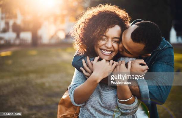 you kisses still give me butterflies - young couple stock pictures, royalty-free photos & images