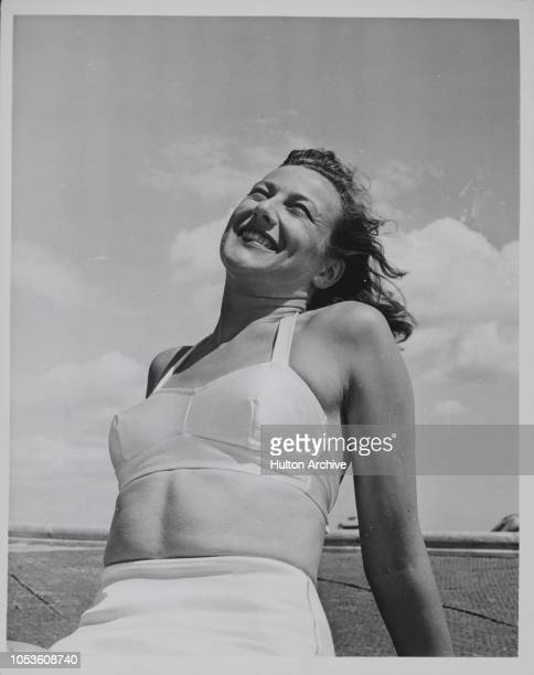 You may not know the face, but you 've heard the voice often enough. Radio and caberet singer 'Dame' BARBARA SUMNER relaxes in suitable costume at...