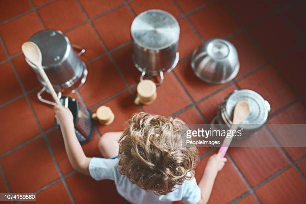 you see pots and pans, he sees a drum set - innocence stock pictures, royalty-free photos & images