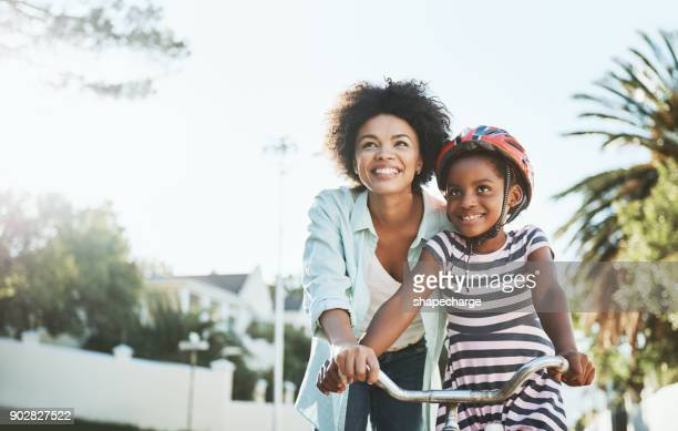 you will see it's easy to ride a bicycle - one parent stock pictures, royalty-free photos & images