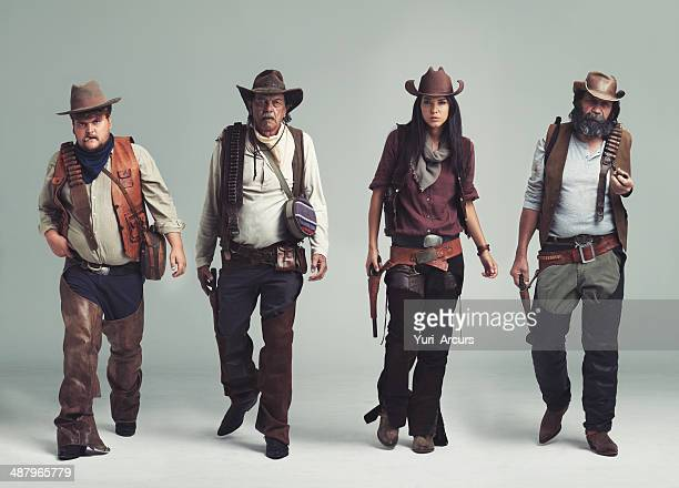 you won't find a more diabolical band of outlaws! - wild west stock pictures, royalty-free photos & images