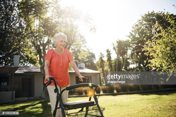 you won't find her indoors on a day like this - walking cane stock photos and pictures
