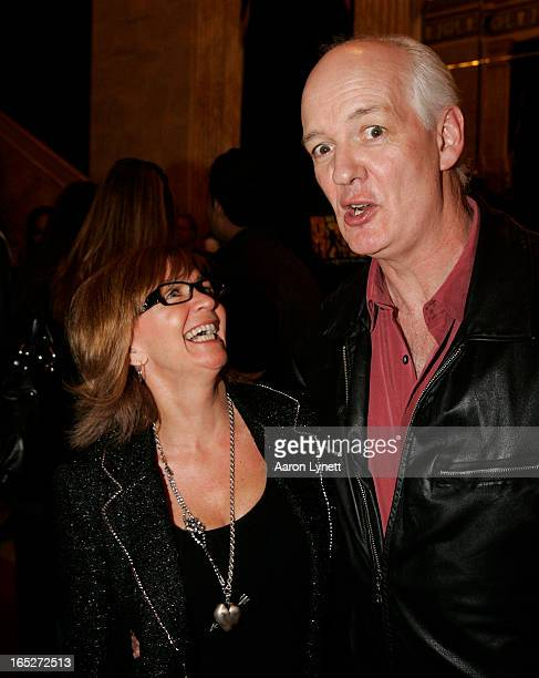 Actor and comedian Colin Mochrie hams it up on the red carpet with his wife Debra McGrath at the opening night of the new musical 'We Will Rock You',...