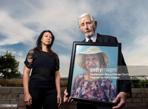 Youanness Assad right, with his daughter Mary Assad, holds a photo of his deceased wife, Afaf Assad in Anaheim on Wednesday, September 25, 2019. Afaf...