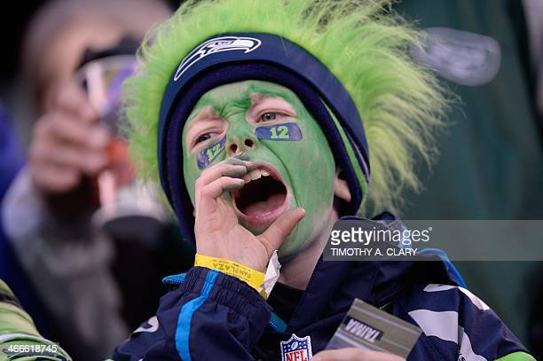 A youbng Seattle Seahawks fan cheers before Super Bowl 48 against the Denver Broncos at MetLife stadium in East Rutherford New Jersey on February 2...