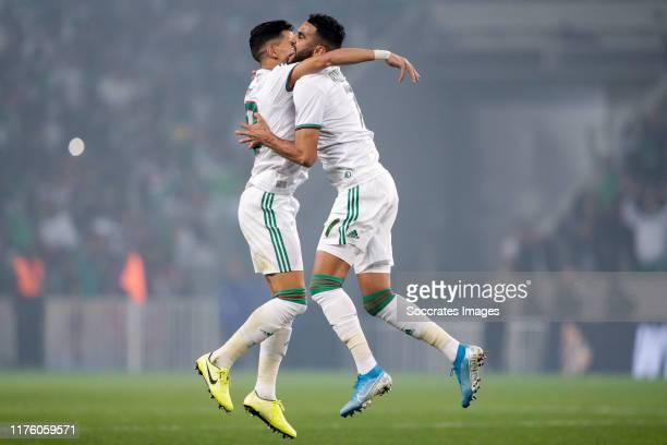 Youcef Atal of Algeria Riyad Mahrez of Algeria celebrates the 20 during the International Friendly match between Algeria v Colombia at the Stade...
