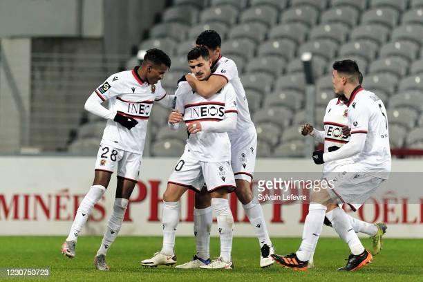 Youcef Atal of OGC Nice celebrates with teammates after scoring his team's first goal during the Ligue 1 match between RC Lens and OGC Nice at Stade...