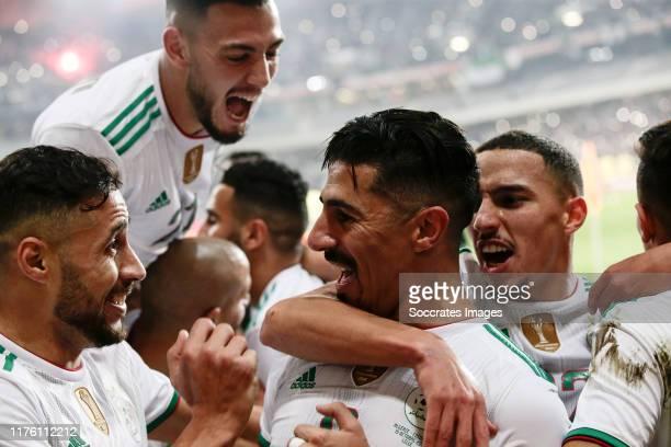 Youcef Belaili of Algeria Baghdad Bounedjah of Algeria Ismael Bennacer of Algeria celebrates the 10 during the International Friendly match between...