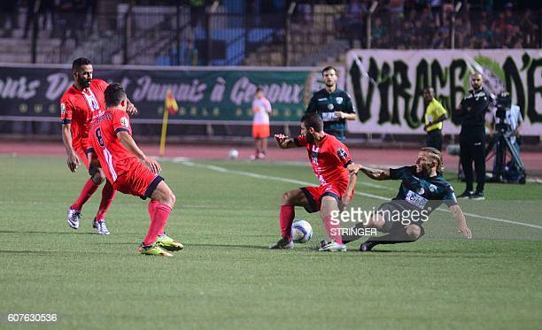 Youcef Grey Laid Touati of MO Bejaia loses the ball against FUS Rabat players in the first leg of the 2016 Caf Confederation Cup semifinal at the...