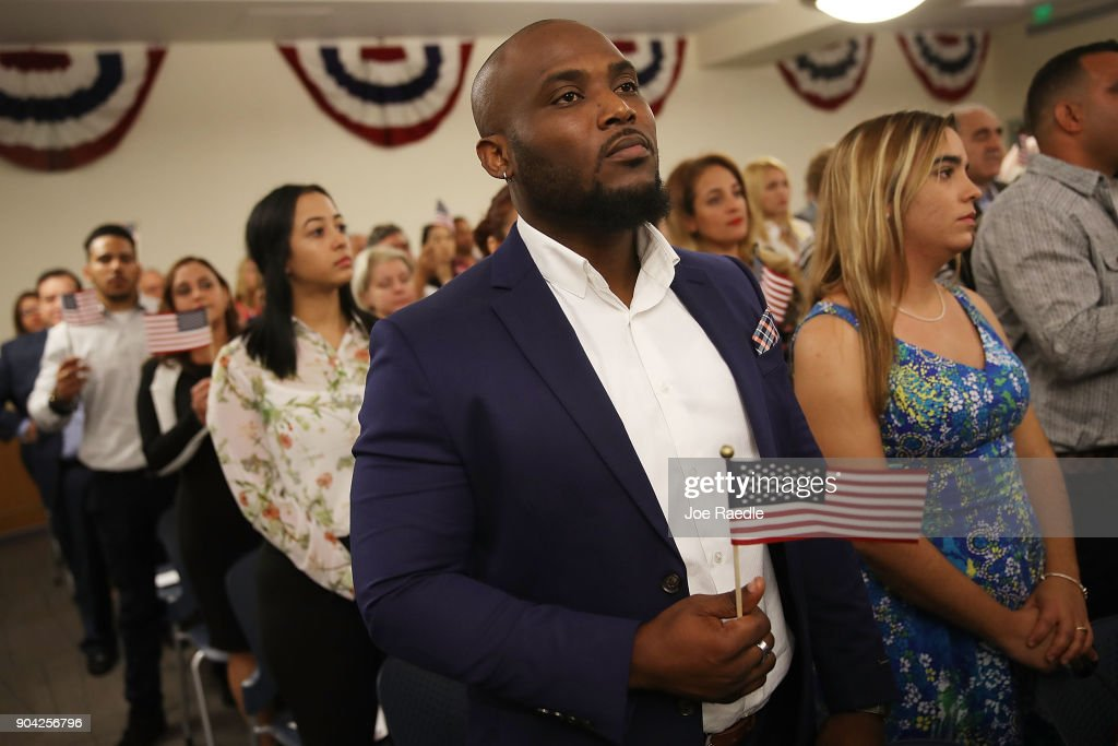 Youdelyn Momperemier, orginally from Haiti, becomes an American citizen during a U.S. Citizenship & Immigration Services naturalization ceremony at the Hialeah Field Office on January 12, 2018 in Hialeah, Florida. 150 people from different countries around the world took part in the Oath of Allegiance.