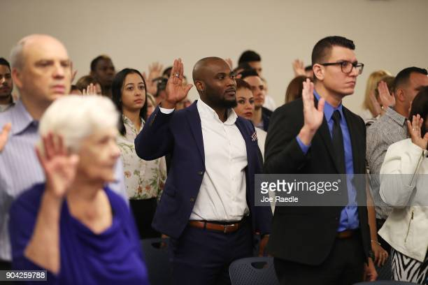 Youdelyn Momperemier orginally from Haiti becomes an American citizen during a US Citizenship Immigration Services naturalization ceremony at the...
