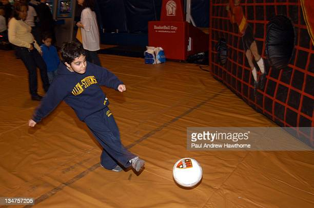 A youg fans tries a shot at the NY Metrostars booth