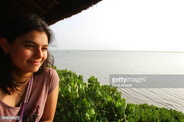 A Youg Girl Enjoying the view at Amazon in Brazil