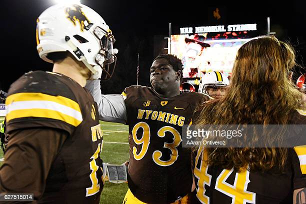Youhanna Ghaifan of the Wyoming Cowboys consoles Josh Allen after the second half of San Diego State's 2724 win on Saturday December 3 2016 The...