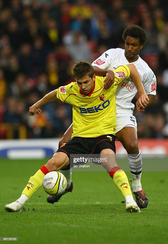 Youl Mawene of Preston tries to tackle Tamas Priskin of Watford during the Coca-Cola Championship match between Watford and Preston North End at Vicarage Road on October 04, 2008 in Watford, England.