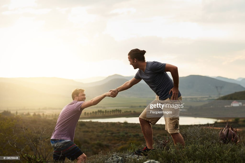 You'll aways find a helping hand on the trail : Stock Photo