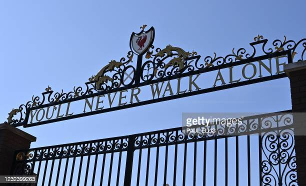 """You'll Never Walk Alone"", lyrics from a song by Gerry and the Pacemakers, is pictured on the Shankly Gates at Anfield stadium, home of English..."
