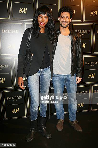 Youma Diakite and Fabrizio Ragone attend Balmain For HM Collection Preview Photocall on November 3 2015 in Rome Italy
