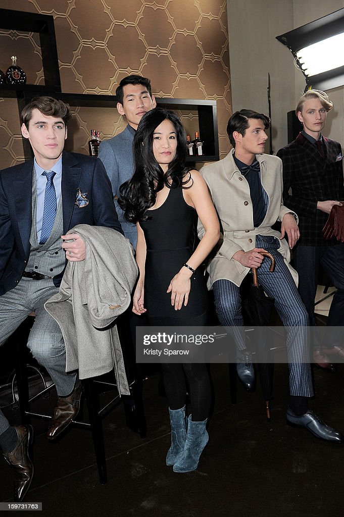 Youn Chong Bak poses with models during the Smalto Menswear Autumn / Winter 2013 show as part of Paris Fashion Week on January 19, 2013 in Paris, France.