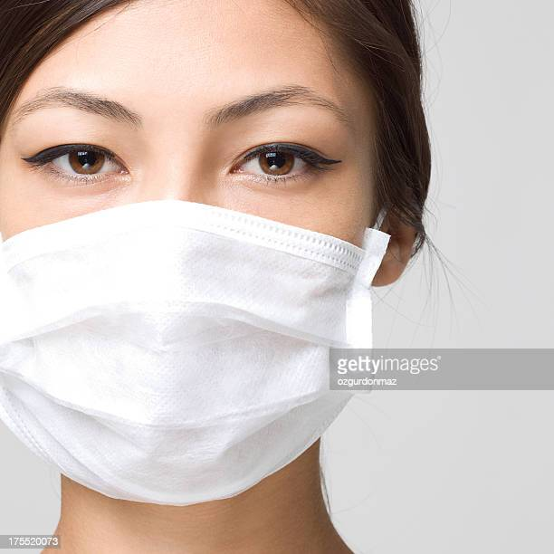 Youn Woman Wearing Medical Face Mask