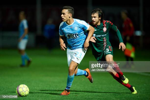 Younes Bakiz of FC Roskilde and Filip Lesniak of AaB Aalborg compete for the ball during the Danish SYDBANK Pokalen Cup match between FC Roskilde and...