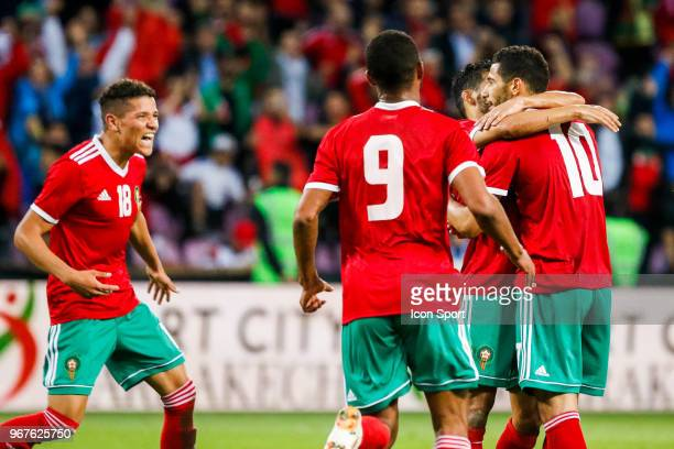 Younes Behanda Amine Harit and Ayoub El Kaabi of Morocco celebrate during the International Friendly match between Morocco and Slovakia at Geneva on...