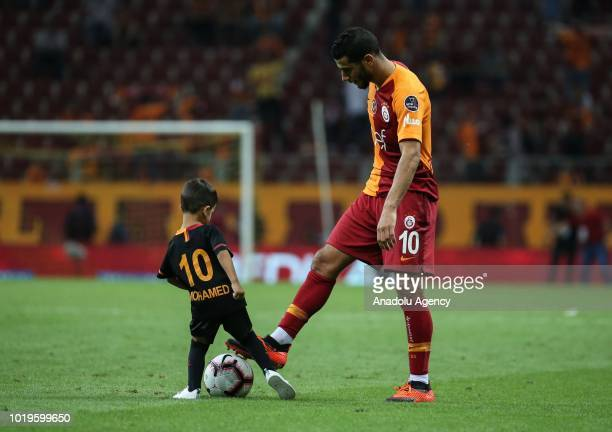 Younes Belhanda of Galatasaray and his son Muhammed play with the ball after Galatasaray won the Turkish Super Lig soccer match against Goztepe at...