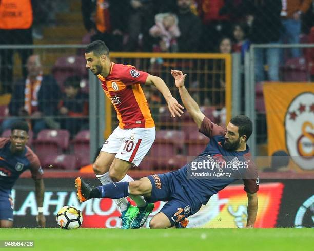 Younes Belhanda of Galatasaray in action against Arda Turan of Medipol Basaksehir during the Turkish Super Lig soccer match between Galatasaray and...