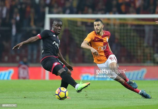 Younes Belhanda of Galatasaray in action against Diallo Guidileye of Genclerbirligi during a Turkish Super Lig match between Galatasaray and...
