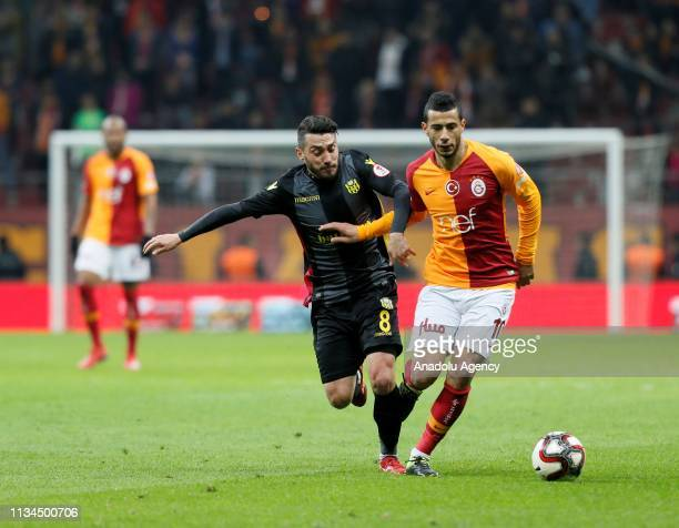 Younes Belhanda of Galatasaray in action against Guilherme Marques of Evkur Yeni Malatyaspor during Ziraat Turkish Cup semi final first leg soccer...