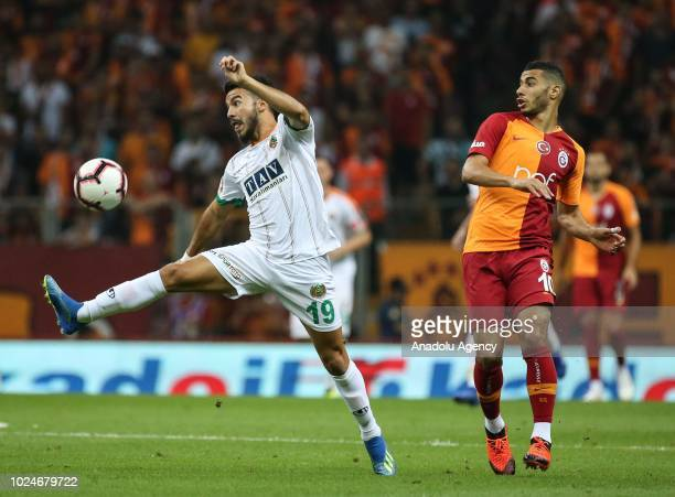 Younes Belhanda of Galatasaray in action against Lucas Villafanez of Aytemiz Alanyaspor during Turkish Super Lig soccer match between Galatasaray and...