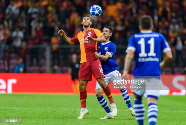 Younes Belhanda of Galatasaray in action against Mark Uth of Schalke during the Group D match of the UEFA Champions League between Galatasaray and FC...