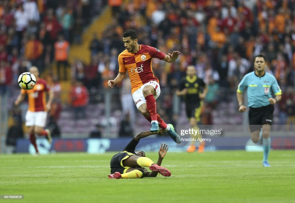 Younes Belhanda (top) of Galatasaray in action against Okechukwu Azubuike (ground) of Evkur Yeni Malatyaspor during the Turkish Super Lig match between Galatasaray and Evkur Yeni Malatyaspor at Turk Telekom Stadium in Istanbul, Turkey on May 12, 2018.