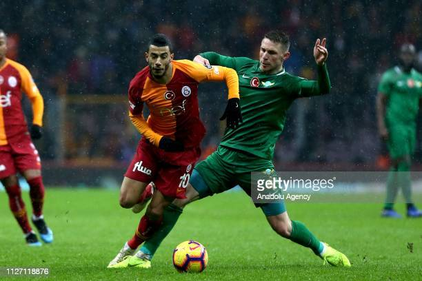 Younes Belhanda of Galatasaray in action against Rajko Rotman of Akhisarspor during the Turkish Super Lig soccer match between Galatasaray and...