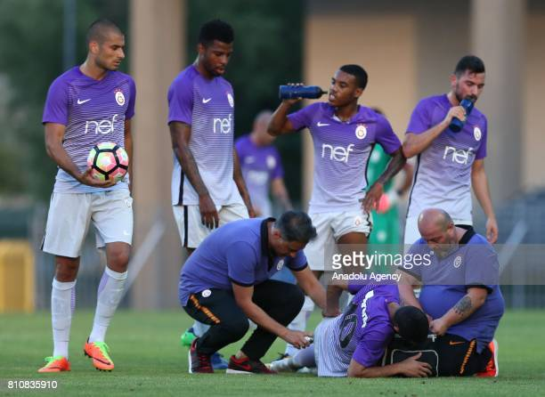 Younes Belhanda of Galatasaray receives first aid as he slightly injured during a preparation match between Galatasaray and Gyor Football Team at ETO...