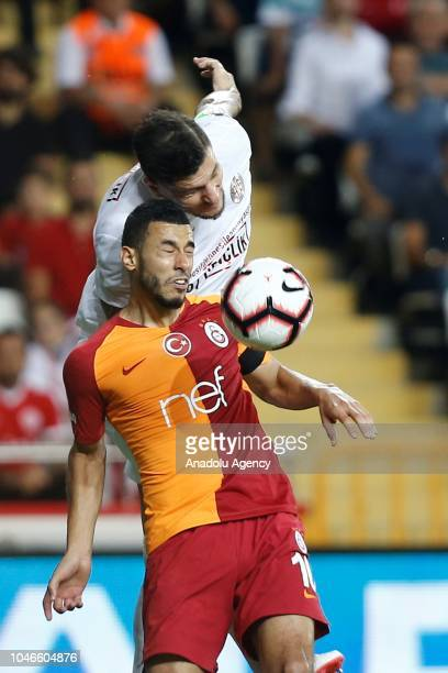 Younes Belhanda of Galatasaray rises for a high ball during the Turkish Super Lig soccer match between Antalyaspor and Galatasaray at Antalya Stadium...