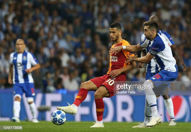 Younes Belhanda of Galatasaray with Hector Herrera of FC Porto in action during the UEFA Champions League Group D match between FC Porto and...