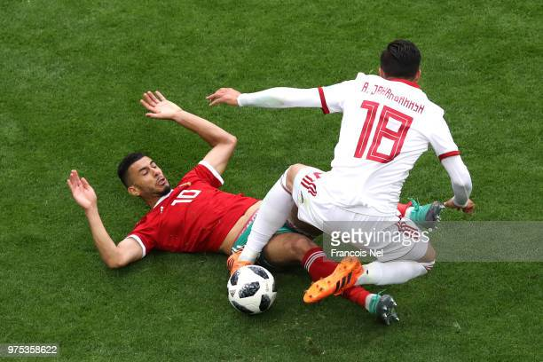 Younes Belhanda of Morocco and Alireza Jahanbakhsh of Iran clash during the 2018 FIFA World Cup Russia group B match between Morocco and Iran at...