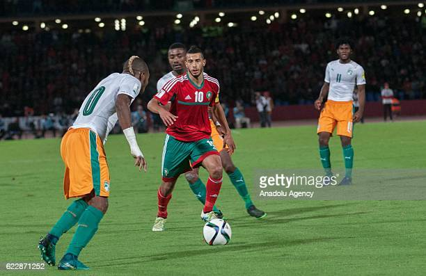 Younes Belhanda of Morocco vies with Serey Die of Ivory Coast during the 2018 World Cup qualifying Group C football match between Morocco and Ivory...